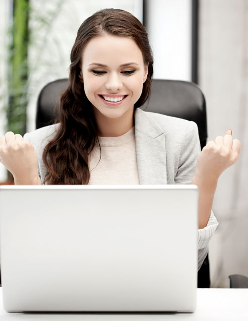 A woman celebrating at a computer