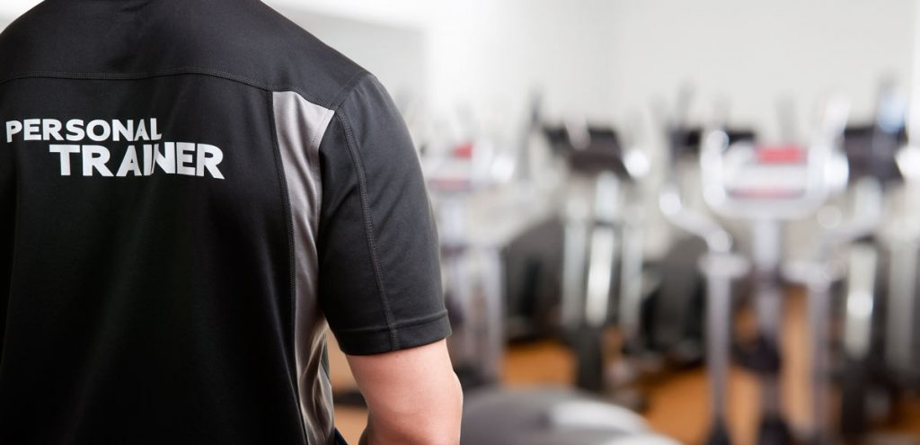 A trainer in a gym after cerification. Most gyms require certification but usually not licenses